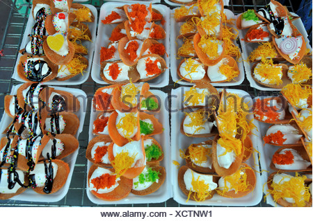 Thailand Khon kaen Crispy Thai pancakes Khanom Buang coconut cream filling various toppings such shredded coconut eggs yolk - Stock Photo