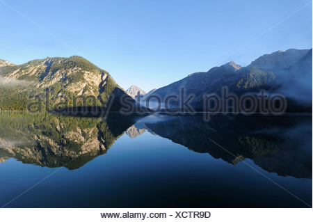 Plansee Lake, Ammergau Alps, Ammergebirge Mountains, looking towards Thaneller Mountain in the Lechtal Alps, Tyrol, Austria - Stock Photo