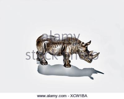 Toy rhinoceros on white background, close-up - Stock Photo