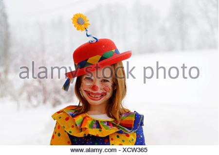 Clown girl in carnival costume - Stock Photo