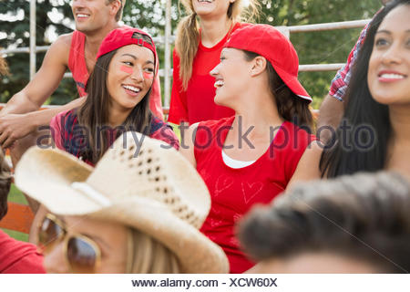 Women talking at sporting event - Stock Photo