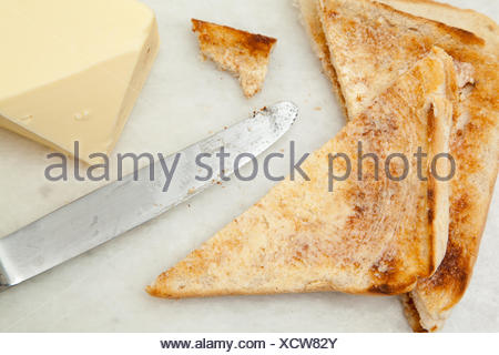 Slices Of Toast And Butter - Stock Photo
