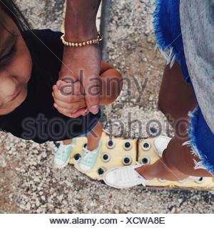 Cropped Mother Holding Hands With Daughter - Stock Photo