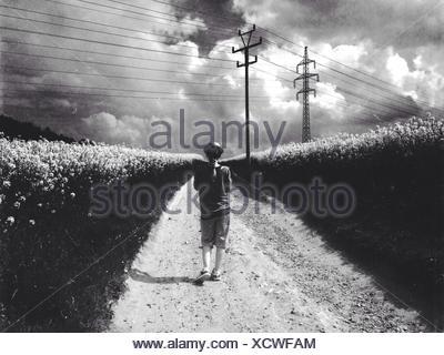 Woman Walking Through Field - Stock Photo