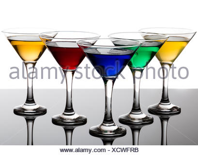 color cocktails in martini glasses - Stock Photo
