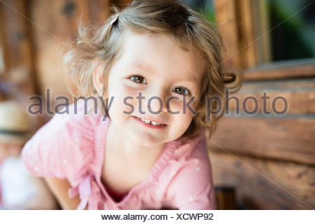 Portrait of little girl with blond hair - Stock Photo