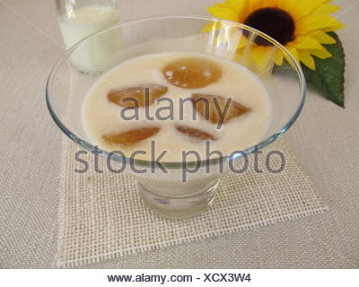 coffee ice cubes in milk - Stock Photo