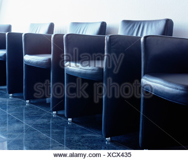 Leather chairs in hospital waiting room - Stock Photo