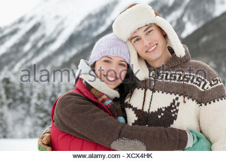 portrait of couple in the snowy outdoors - Stock Photo