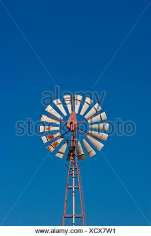 blue wind energy water wheel firmament sky unclouded cloudless pinwheel blue - Stock Photo