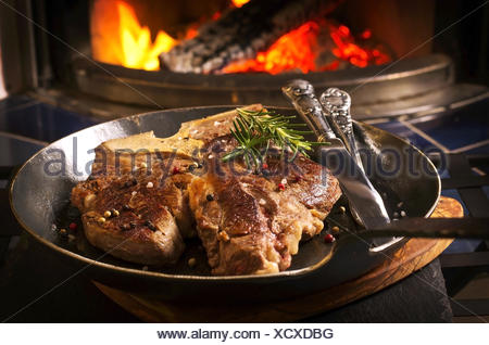 t-bone steak on the frypan - Stock Photo