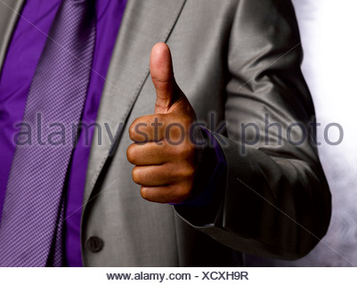 Business man giving thumbs up - Stock Photo