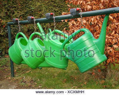 cemetery care gardener watering-can nurse grave care consumption green chain - Stock Photo