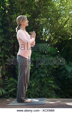 profile of woman in yoga pose - Stock Photo