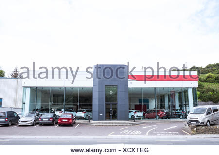 Outside view of car dealership - Stock Photo
