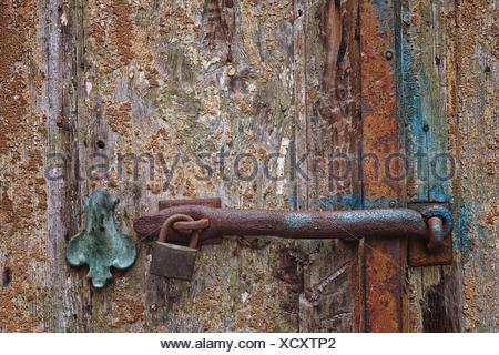 Rusty lock on wooden door - Stock Photo