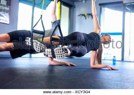 Couple doing side plank exercise - Stock Photo