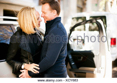 Man and woman happy to meet again - Stock Photo