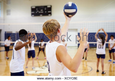 High School Volleyball Match In Gymnasium - Stock Photo