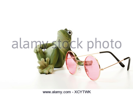 Frog and rose-coloured glasses - Stock Photo