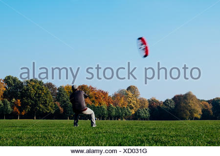 Man Flying Kite Against Clear Sky - Stock Photo