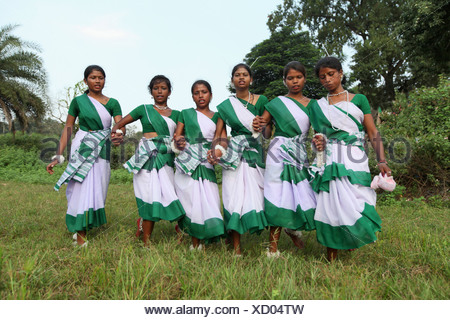 Tribal girls performing a typical tribal dance in traditional outfits. Oraon tribe.  District Hazaribaug, Jharkha - Stock Photo