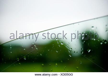 Raindrops on car window - Stock Photo