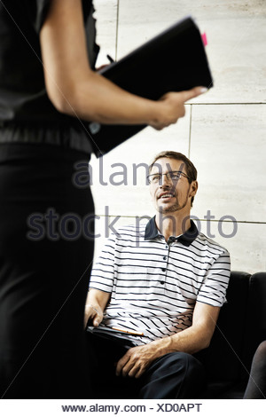 Man working with a woman - Stock Photo