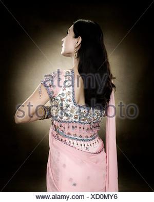 Rear view of a hindu woman - Stock Photo