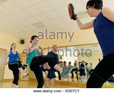 aerobic kick exercise at gym - Stock Photo