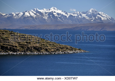 View from the Isla del Sol, Island of the Sun, in Lake Titicaca towards the Andes Mountains, Copacabana, Bolivia, South America - Stock Photo