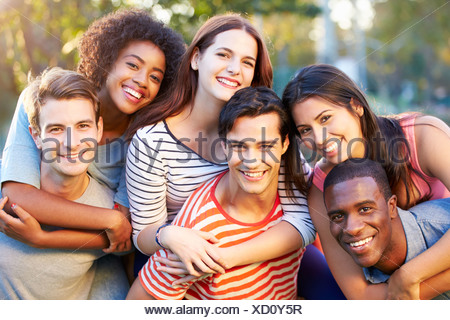 Outdoor Portrait Of Young Friends Having Fun In Park - Stock Photo