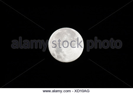 Full moon against dark sky - Stock Photo