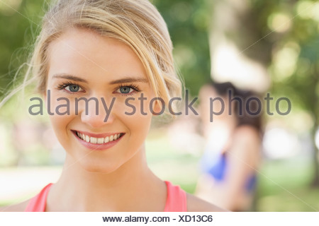 Gorgeous young blonde woman posing in a park - Stock Photo