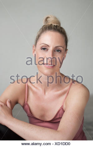 Portrait of a mid adult woman smiling, Munich, Bavaria,  Germany - Stock Photo