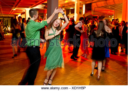 Young couple dancing at the prom of a dance school, Germany - Stock Photo