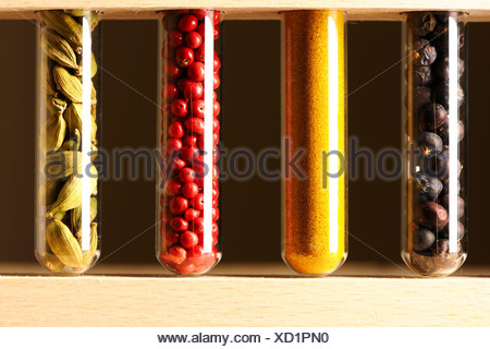 Spices in beakers - Stock Photo