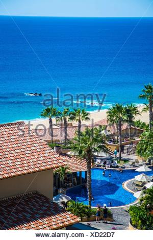 Gorgeous view of the Resort in Cabos San Luca, Baja California, Mexico. View of the ocean, and many infinity pools, people lounging and enjoying the - Stock Photo