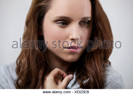 A young woman looking thoughtful - Stock Photo