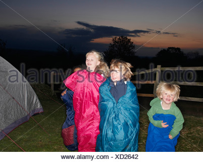 Sleeping bag races at dusk - Stock Photo