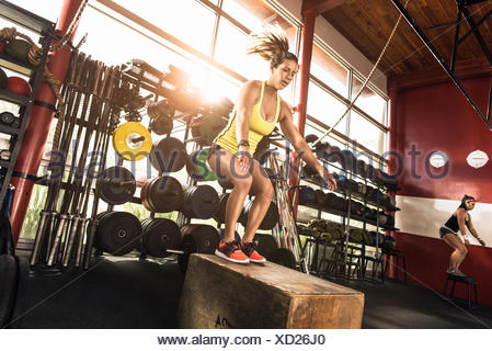 Bodybuilders working out in gym - Stock Photo
