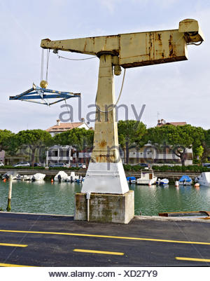 old boat davit at the quay - Stock Photo