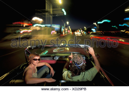 Pink Cadillac, People, driving, Albuquerque, New Mexico, USA, United States, America, 1962, car, convertible, by night - Stock Photo