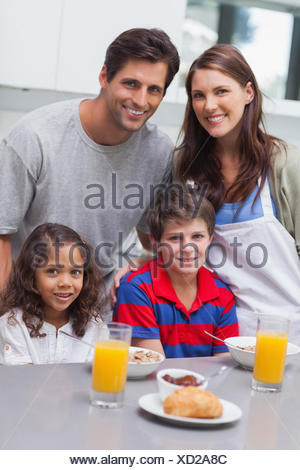 Happy family in the kitchen - Stock Photo