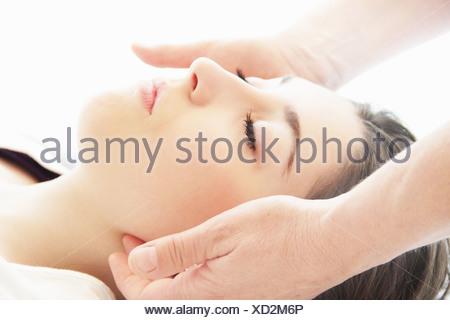 Woman having facial massage in spa - Stock Photo