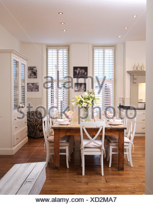 White Chairs At Simple Wood Table In Modern White Kitchen Dining Room With  Wooden Flooring And