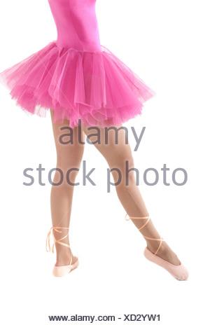 Unrecognizable female dancer with tutu isolated on white background. - Stock Photo