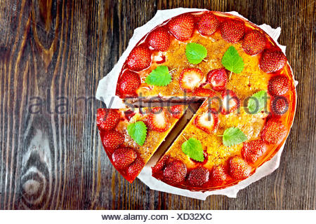 Pie strawberry with jelly on dark board top - Stock Photo