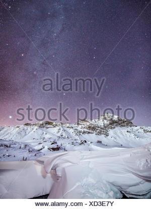 The Milky Way over the Pizzo Scalino, Scalino Peak in Valmalenco, Valtellina, Italy - Stock Photo
