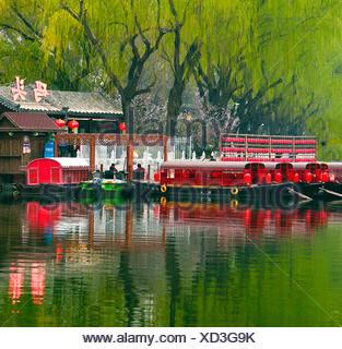 Dinner boats await customers at early twilight,Shichahai (Houhai) District at Twilight,Beijing,China. - Stock Photo
